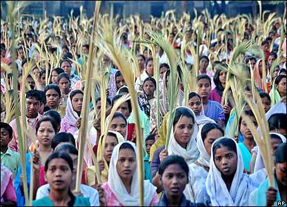 In Ranchi, India, Christian devotees waved palm fronds, which represent the palm leaves people laid at Jesus' feet as he entered Jerusalem in his final week of life