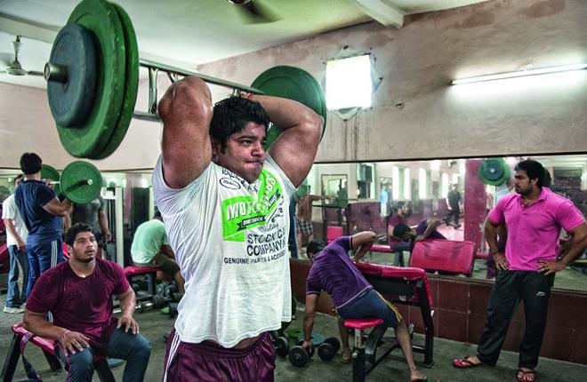 Neeraj Tanwar pumps his 19.5-inch biceps at the village gym