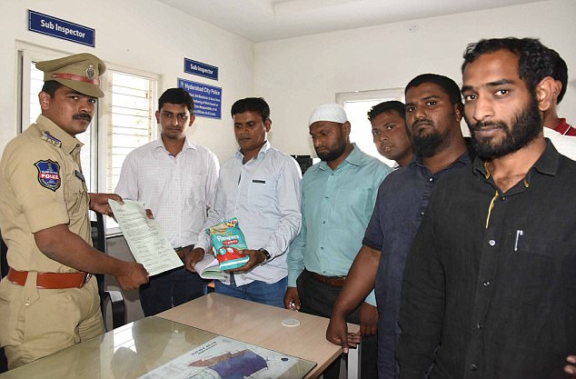 Protest: Activists from the Islamic group Darsgah Jihad-o-Shahadat yesterday lodged a formal complaint about the nappies at Dabeerpura Police Station in Hyderabad Read more: http://www.dailymail.co.uk/news/article-5418129/Muslims-burn-Pampers-nappies-cartoon-cat.html#ixzz57sIRLMYc Follow us: @MailOnline on Twitter | DailyMail on Facebook