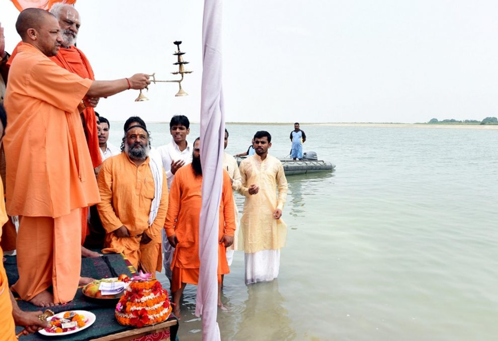 Ayodhya: Uttar Pradesh Chief Minister Yogi Adityanath offer prayers at the Saryu river in Ayodhya, Uttar Pradesh on May 31, 2017. (Photo: IANS)