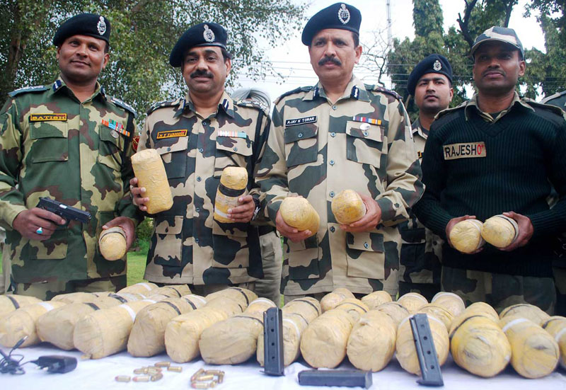 Amritsar BSF officers and jawans display 41 kg of heroin, worth Rs 205 crore in international market, recovered from two separate incidents, near indo-pak international border out post Daoke and Rattan khurd about 45km from Amritsar on Tuesday. PHOTO-RAMAN GILL AMRITSAR