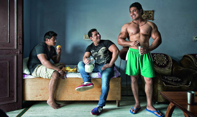 (From left) Bouncers Kuldeep Tanwar, Vikram Sharma and Vikram Tanwar get their daily milk and protein fix. By Reuben Singh