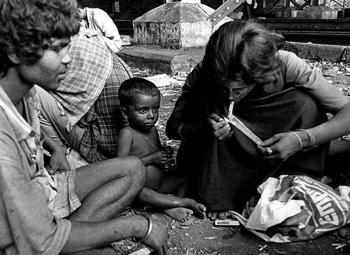 A woman sniffs brown sugar near an over bridge in Amritsar. Photo-Prabhjot Gill