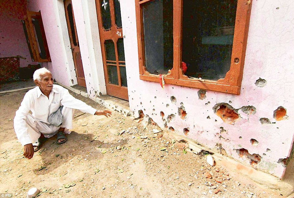 A resident of Chilayari village in Jammu shows the damage inflicted on his house by Pakistani shelling.