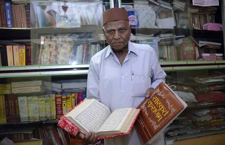 Mumbai: Renowned Sanskrit scholar Pandit Gulam Dastagir at his home in Worli, Mumbai on Dec. 27, 2014. (Photo: Sandeep Mahankal/IANS)