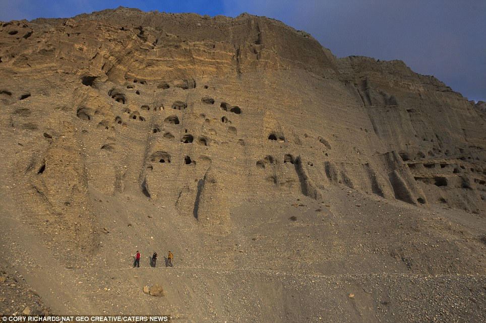 Bizarre: With dozens of holes carved into the fragile, sandy-coloured cliff face this unusual 'neighbourhood in the sky' looks like a giant sandcastle