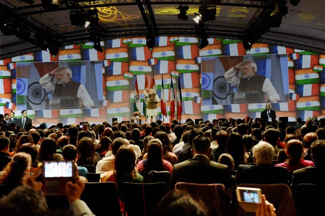 Prime Minister Narendra Modi address during a community reception at Carrousel du Louvre in Paris. PTI Photo