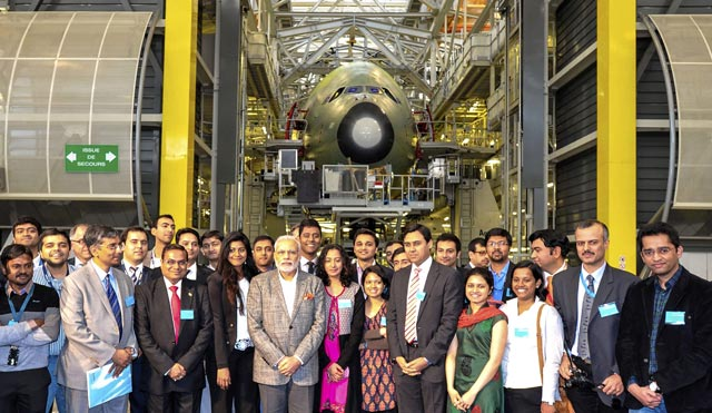 Prime Minister Narendra Modi poses with Indian students during a visit at the Airbus headquarters in Toulouse. Reuters Photo