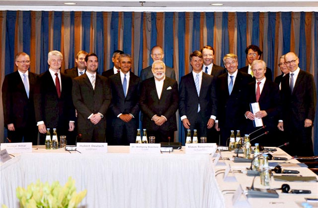 Prime Minister Narendra Modi with German CEOs during the round table meeting in Hannover. PTI Photo
