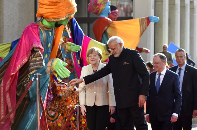 German Chancellor Angela Merkel (L) and Prime Minister Narendra Modi (2nd L) attend the official opening of the Hannover Messe industrial trade fair in Hanover, central Germany. AFP Photo