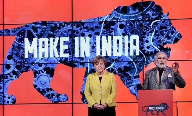 Prime Minister Narendra Modi speaks as German Chancellor Angela Merkel at the India Pavilion at Hannover Messe, a business fair, in Germany. PTI Photo