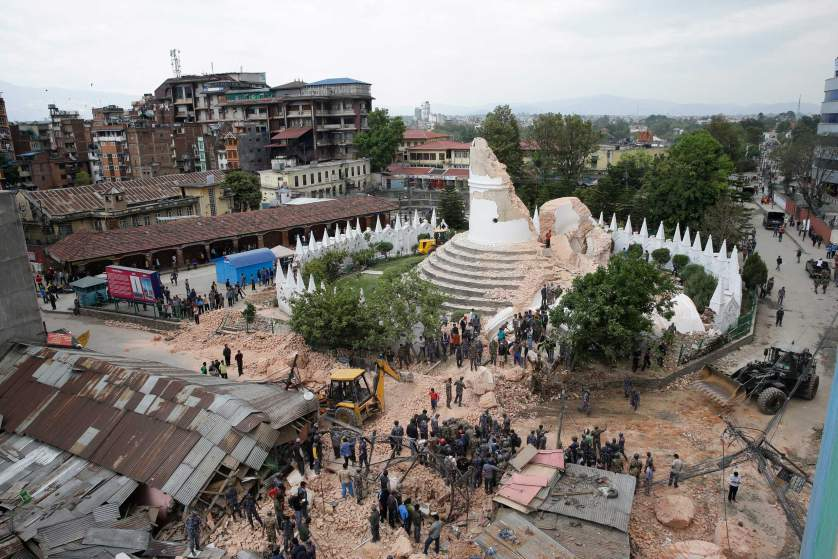 People inspect the damage of the collapsed landmark Dharahara, also called Bhimsen Tower, after the earthquake. SHARE