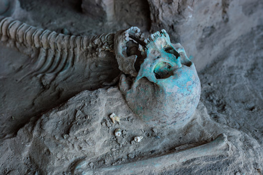Stained by copper in the soil, a skeleton lies next to a stupa at Mes Aynak. Whether the individual lived when the monasteries were functioning or in a later era is unknown.