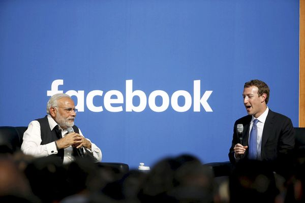 Indian Prime Minister Narendra Modi and Facebook CEO Mark Zuckerberg speak on stage during a town hall at Facebook's headquarters in Menlo Park, California September 27, 2015. REUTERS/Stephen Lam
