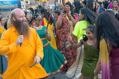 Swami Nikhilanand dances with a young Hindu girl during the Raas Garba at a Janmashtami festival in New York.