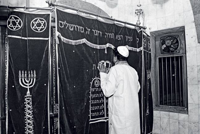 A Jewish devotee at the Holy Ark. Photo: Danesh Jassawala